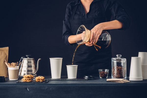 Professional barista preparing coffee alternative method